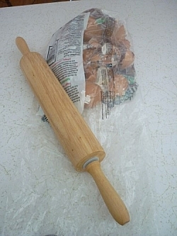 Rolling pin and bag of dried out egg shells ready to be crushed.