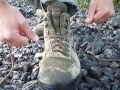 Demonstrating the proper way to lace up hiking boots.