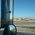 One of the advanced uses of CouchSurfing is catching a rideshare, like trucking through the Prairies pictured here.