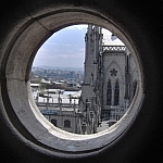 View of Quito through a round window of the Basilica del Voto Nacional.