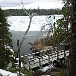 A bridge over a small stream on Lake Nipissing's Coastal Trail, as seen from Mashkinonje Park's Atakas Trail.