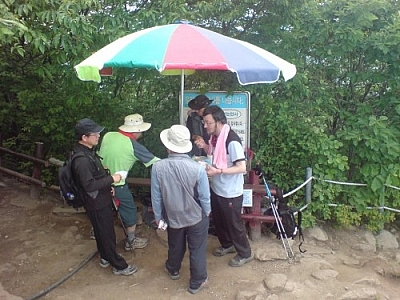 If the old man from that bus ride near Jeonju had seen this crowd of hikers gathered around a vendor's cart on a mountain peak, he wouldn't have worried about me hiking alone.