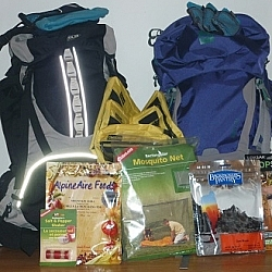 Our new backcountry gear: two backpacks, dehydrated meals, organizer bags, microfiber towels, mosquito net, camp-sized salt and pepper shakers...