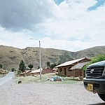 A pig crosses the road outside of Cusco.