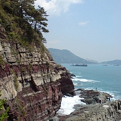 Coastal scenery showing interesting sedementary layers on the seaside cliffs, seen in Amnam Park, Busan.