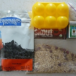 Meal plans for backcountry hikers can include dehydrated meals, eggs, energy bars, tea, and oatmeal.