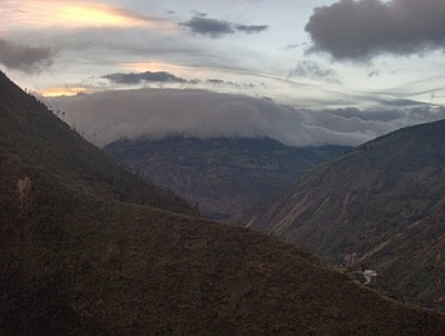 Clouds hugging a mountaintop, seen while hiking in Baños.