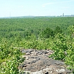 Sudbury visible in the distance from this rocky hilltop.