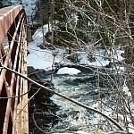 A bridge crossing over a river at Arrowhead Provincial Park.