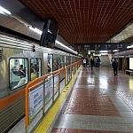 Inside a Busan subway station, on the waiting platform...