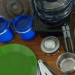 Hand toaster, stove, nesting pots and fuel, mugs, plates, camp utensils, spatula, measuring cup