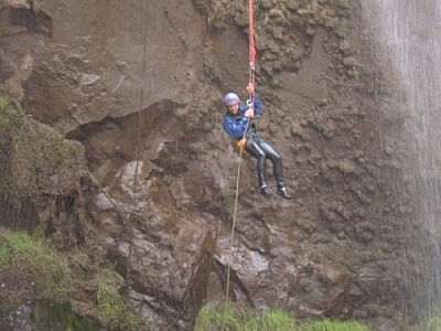 Dangling in the air while repelling down a waterfall.