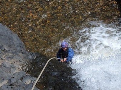 Canyoning down the second set of falls while repelling in Baños.