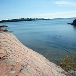 Smooth pink granite beside clear Georgian Bay waters
