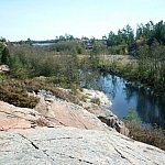 Chikanishing Creek cuts narrowly through pink granite towards Georgian Bay.