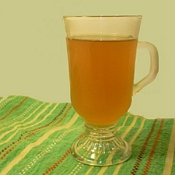 A cup of my homemade kombucha tea sitting pretty as I explain some common misconceptions about kombucha tea.