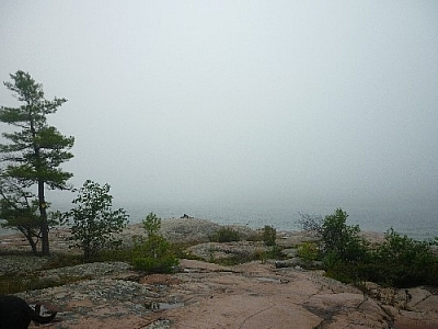 A foggy Georgian Bay hides just past a pink granite rock outcrop near Killarney's East Lighthouse.