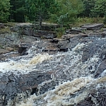 Close-up of Duchesnay Falls shows rough waters.