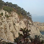 A rocky cliff seen from the trail on Dusongsan Peninsula, Busan.