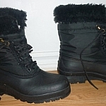 Layering winter wear for warmth with felt-lined winter boots.