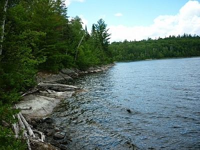 Hiking up Rib Mountain can start at this choppy stretch of the rocky, thickly forested Friday Lake shoreline.