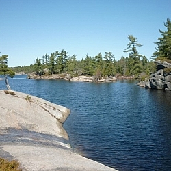 Rocky shoreline of winding waters at Grundy Lake Provincial Park.