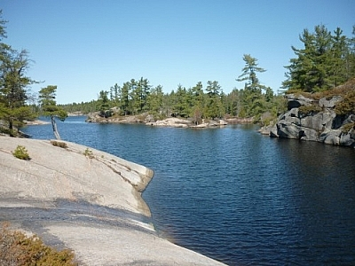 Outdoor recreation on the rocky shoreline of winding waters at Grundy Lake Provincial Park.