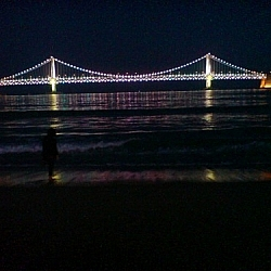 The Gwangan Grand Bridge all lit up, seen at night from Gwangalli Beach.