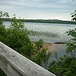 Lake view while crossing a wooden bridge on Hawk Ridge Trail.
