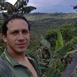 Close-up of the centre's only employee posing for the camera while hiking at Merazonia, with beautiful Amazonian and Andean scenery in the background.
