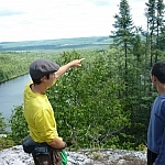 The boys pointing out possible fishing spots from the lookout point above the Brush Lakes on Bear Mountain.