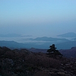 Catching sunrise from a peak while trekking Jirisan is an essential part of the experience.