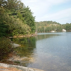 Clear waters by a lakeside campside along Killarney's La Cloche Silhouette loop trail.