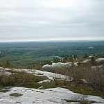 Top of the world at Silver Peak while trekking Killarney's La Cloche Silhouette loop trail.