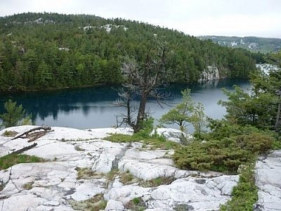 Stunningly beautiful blue lake waters seen while trekking Killarney's La Cloche Silhouette loop trail.