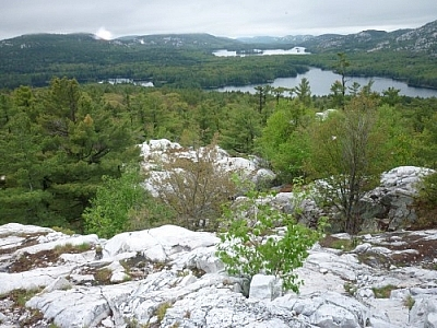 Magnificent vistas of faraway mountains while trekking Killarney's La Cloche Silhouette loop trail.