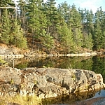 A profile view of a rocky point juts into Lake of the Woods.