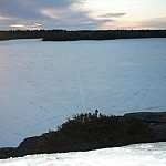 Snowmobile tracks over the lake.