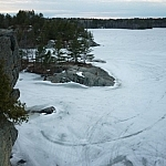 Snowmobilie tracks near the rocky shore of McCrae Lake.