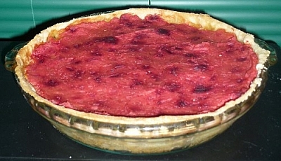 Mixed vegetable pie with a mashed potato and beet top crust.