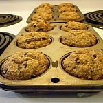 Banana muffins in muffin pans, just taken out of the oven.