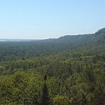 Overlooking a vast forest below the outline of the Niagara Escarpment from the Cup and Saucer Trail in Little Current on Manitoulin Island