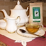 Northern Lights tea beside by an elegant tea setting.