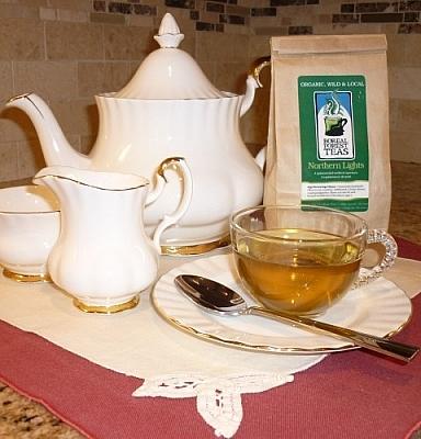 Northern Lights tea beside by an elegant tea setting.