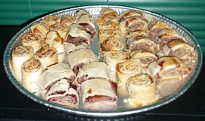 Pètes de Soeurs rolls sliced and arranged on a baking sheet.