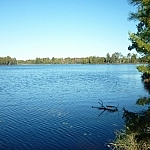 Lac Barbotte, deep blue beneath the bright blue sky.