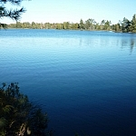 A vast expanse of deep blue water at Lac Barbotte, off of Mayer Road in Noëlville.
