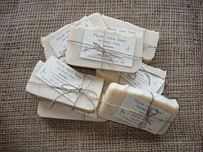 Stack of oatmeal soap, the only packaging a paper label held to the bars of soap with string.