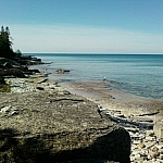 Rocky coastline and clear waters of Providence Bay, Manitoulin Island