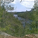 Scenic view of a river flowing into the forest in the distance at Samuel de Champlain Park.
